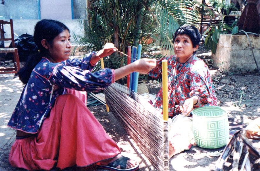 Huichols set up warp for weaving